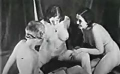 Black and white vintage porn of three women doing a lesbian three-way