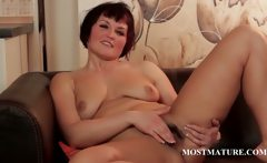Mature hottie touching hairy twat
