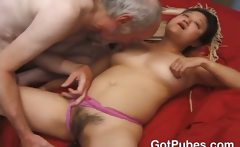 Asian chick with a hairy pussy pleasing a cock