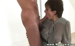 Domina gives him a treat as she gets on her knees