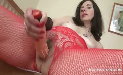 Slutty mature in pantyhose fucks herself with dildo